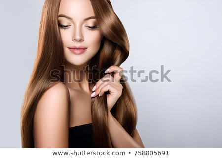 Brunette beauty with shiny healthy hair. Stock photo © lithian