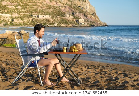 Businessman making call at the beach Stock photo © photography33