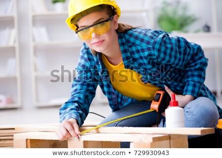 Female carpenter with laminate flooring Stock photo © photography33