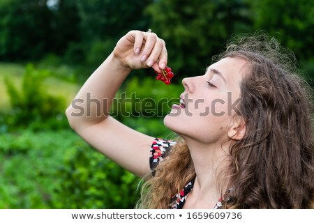 Woman eating redcurrant berries Stock photo © photography33