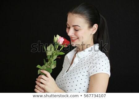 woman holding single rose stock photo © photography33