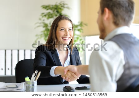 Businessman interviewing a young woman Stock photo © photography33