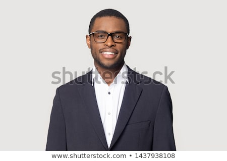 siyah · iş · adamı · poz · kamera · yalıtılmış - stok fotoğraf © get4net