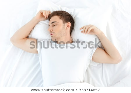 Tranquil man lying on his bed at home Stock photo © wavebreak_media