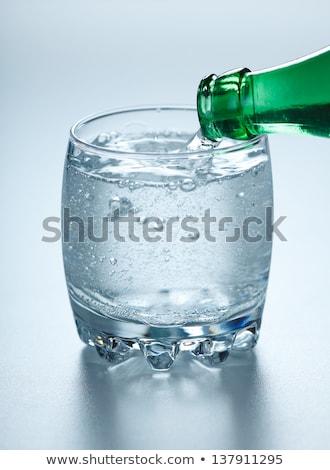 Alto bubbles água mineral para cima vidro limpar Foto stock © icefront