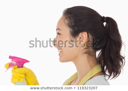 Cheerful woman using a window cleaner wearing rubber gloves Stock photo © wavebreak_media