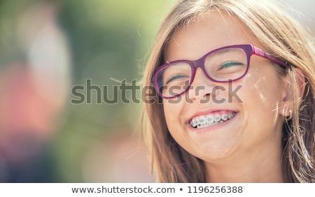 Gelukkig meisje bretels gelukkig glimlachend meisje gezicht Stockfoto © Anna_Om