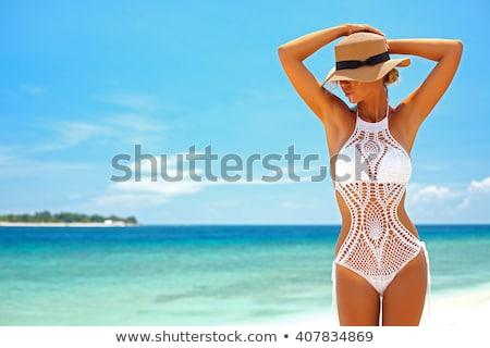 Beautiful young woman wearing white fashionable swimsuit and jew Stock photo © PawelSierakowski