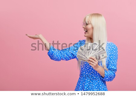 Happy business woman holding fanned banknotes Stock photo © wavebreak_media