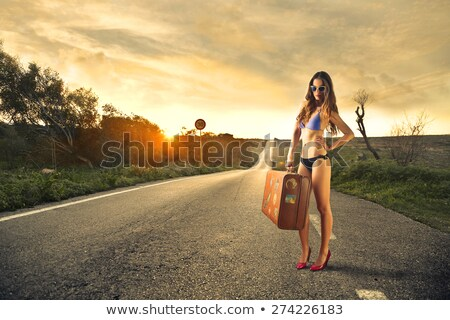 Woman hitchhiking to the beach Stock photo © photography33