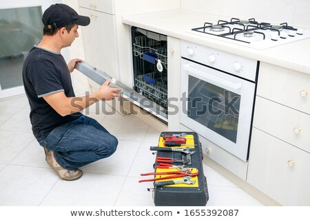 Service Man Kneeling with Clipboard Stock photo © 805promo
