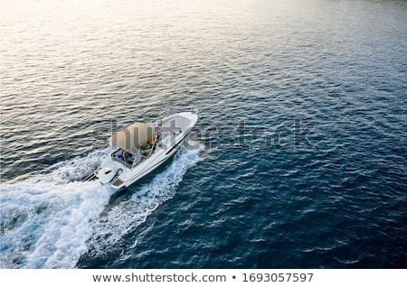 быстро лодка человека вождения лет Сток-фото © songbird