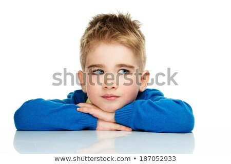 Dreaming little boy in blue cardigan and yellow shirt  Stock photo © Nejron
