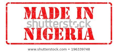Nigeria napis czerwony odizolowany biały Zdjęcia stock © tashatuvango