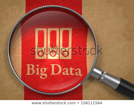 big data glass on old paper stock photo © tashatuvango