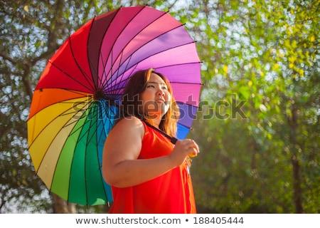 Feliz gorduroso mulher guarda-chuva asiático ao ar livre Foto stock © Witthaya