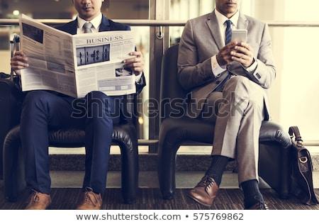 üzletember · olvas · újság · fókusz · üzlet · szavak - stock fotó © elwynn