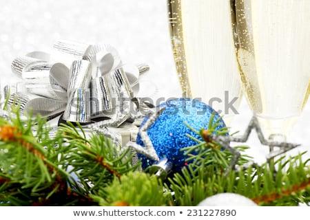 Champagne, blue firtree and christmas decor Stock photo © karandaev