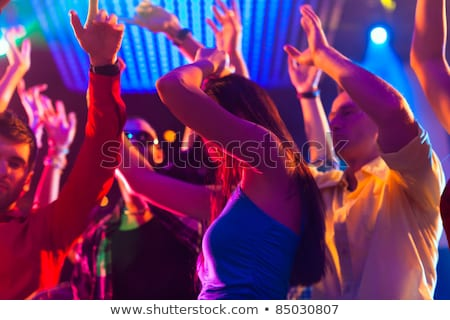 Asian people partying on dance floor in nightclub Stock photo © Kzenon