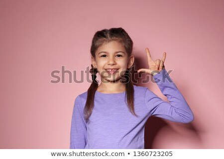girl with gesture of ILY Stock photo © elwynn
