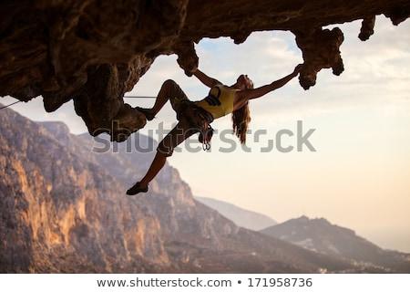 Uomo figura impiccagione rupe sole Foto d'archivio © rudall30