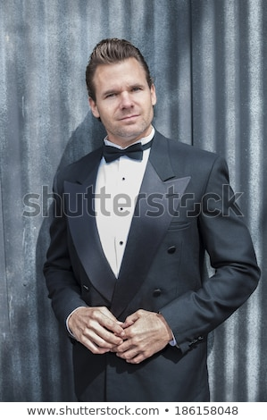 handsome blonde man wearing a tuxedo Stock photo © feedough