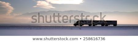 semi truck travels highway over salt flats frieght transport stock photo © cboswell