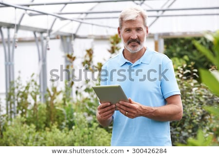 portrait of staff at garden center holding plants stock photo © highwaystarz
