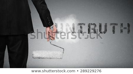 Untruth word painting on wall Stock photo © fuzzbones0