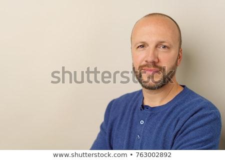 Vonzó középkorú férfi kecskeszakáll visel piros Stock fotó © ozgur