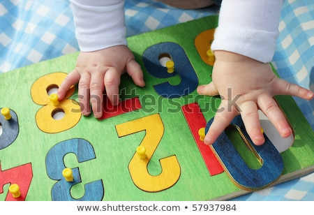 baby with puzzle on finger stock photo © paha_l