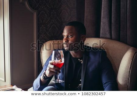 business man drinking wine stock photo © hasloo