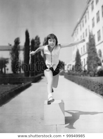 Girl jumping with retro camera Stock photo © svetography