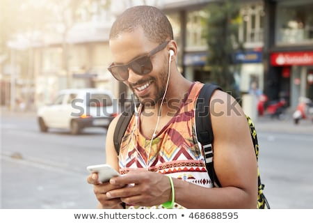 a young black man listening to the music stock photo © bluering