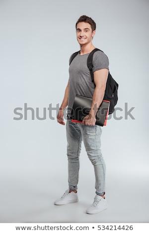 Full length student guy standing on white stock photo © lovleah