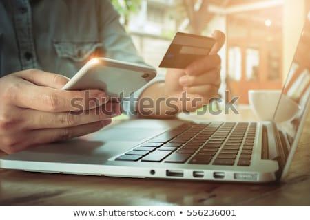 mulher · usando · laptop · escritório · feminino · mesa · de · madeira - foto stock © stevanovicigor