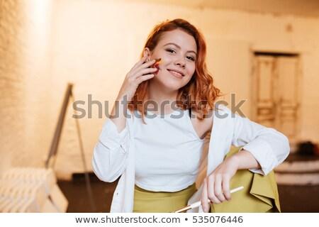 Boldog fiatal vörös hajú nő hölgy festő olaj Stock fotó © deandrobot