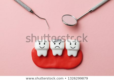 Teeth treatment symbol background Stock photo © Tefi