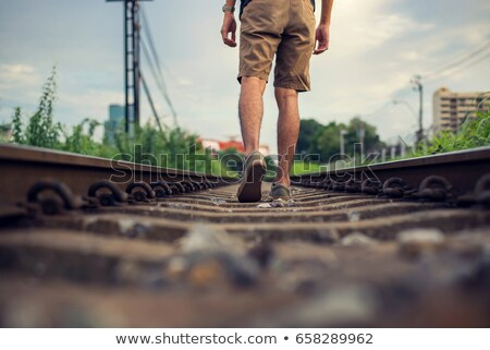 Boy Walking on the Railroad Track Stock photo © courtyardpix