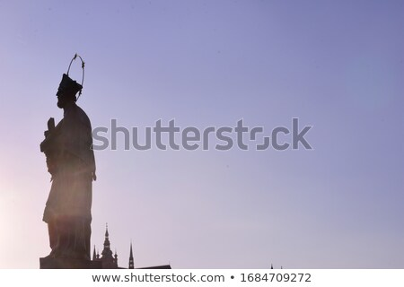 statue of john of nepomuk silhouette at charles bridge prague stock photo © kirill_m