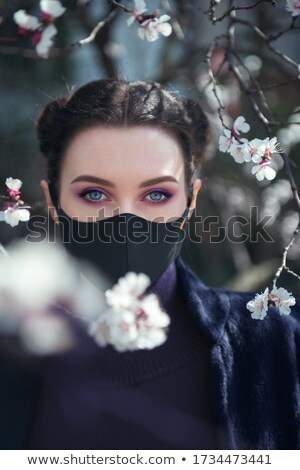 Stock photo: Beauty young real woman with pink flowers and make up closeup, s