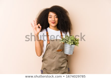 woman planting a garden stock photo © is2