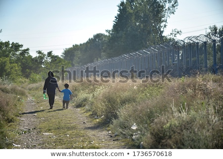 Woman and children next to tents Stock photo © IS2
