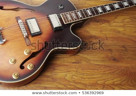 Strings and bridge of an old electric guitar Stock photo © sumners