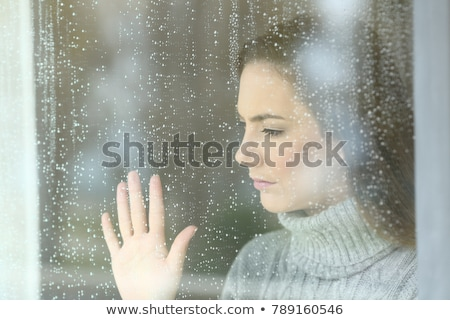 woman looking out window portrait stock photo © is2