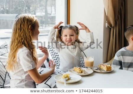 Mosolyog lány játszik étel jókedv kint Stock fotó © IS2