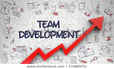 training development drawn on white brick wall 3d stock photo © tashatuvango