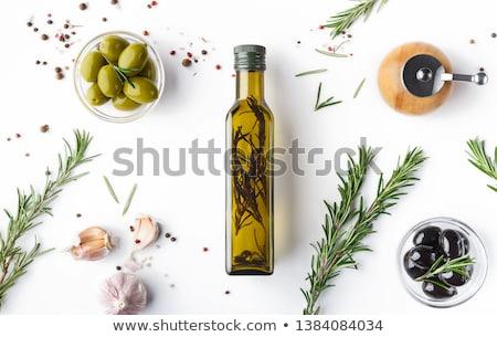 Tigela verde azeitonas alecrim branco fundo branco Foto stock © Digifoodstock
