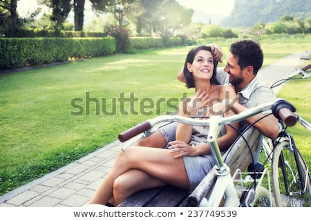 couple with bikes talking stock photo © is2