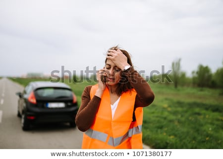 Pretty, young woman calling the roadside service/assistance Stock photo © lightpoet